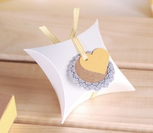 Gift box with yellow ribbon and heart
