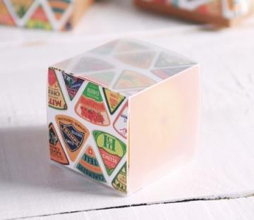 Semi-transparent box with cardboard sleeve
