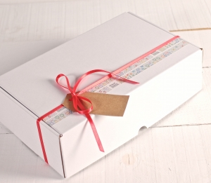 Box decorated with washi tape and red ribbon