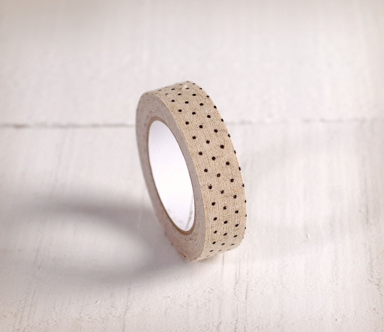 Fabric tape with black spots