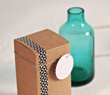 Kraft coloured gift box decorated with washi tape